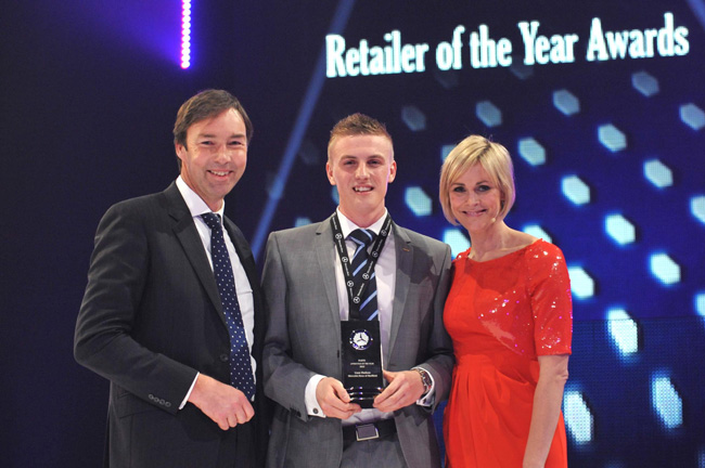 Liam Hudson is presented with his Apprentice of the Year award by Simon Oldfield (left), Managing Director, Customer Services Group, Mercedes-Benz UK, and TV presenter Jenni Falconer, who compered the event