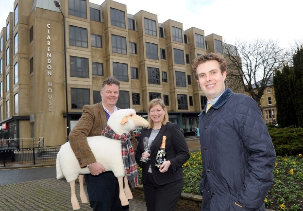 Carter Jonas lettings agent Chris Hartnell_(right) at Clarendon House in Harrogate with new tenants Chris_Tattersall (left) and Catherine Ward-Brown (m