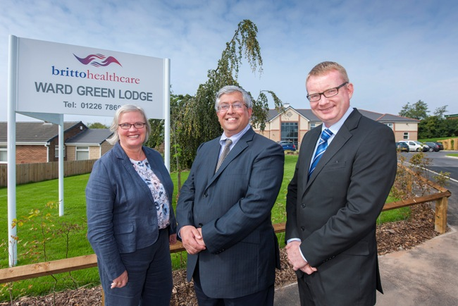 Gail Fielding (left) and David Potts (right) from Yorkshire Bank with Dr Darryl Britto (centre)