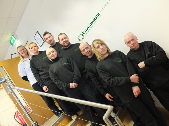 Envirowaste Services team photo in their new branded uniforms