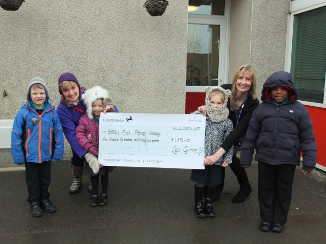 Head Teacher Mrs S Thornton and Pupils Accepting Leo Group's donation