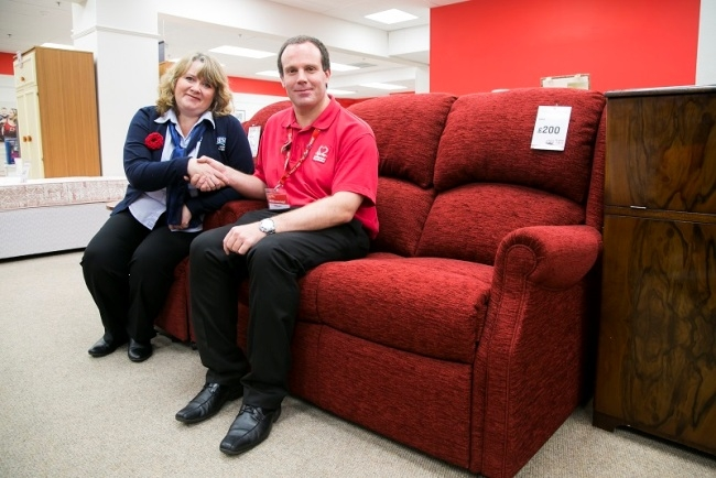 Joanne Wild from HSL and store manager Robert Walton at the British Heart Foundation Furniture and Electrical store, Wakefield, with one of the donated sofas.