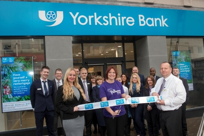 9 November 2015. The opening of the new Yorkshire Bank, Briggate, Leeds. Branch Managers Emma-Jo Beadle and Jim O'Toole help Gail Chapman from St Gemma's Hospice officially open the branch.