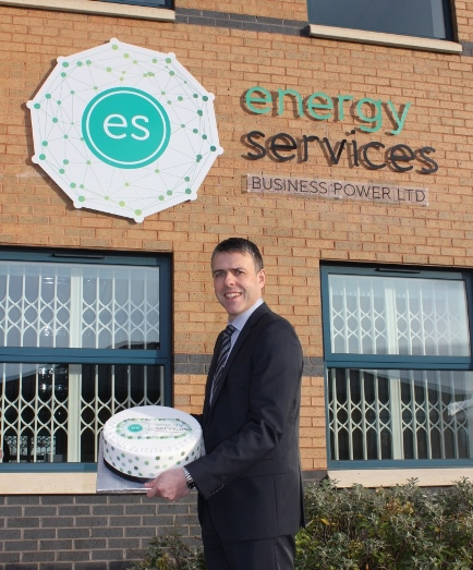 Managing Director Rob Jabczynski poses infront of the new branding with