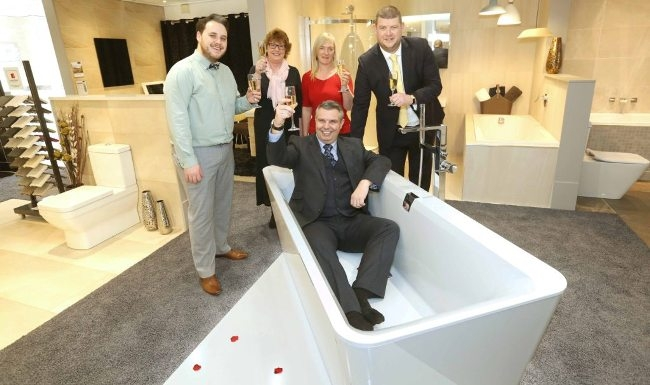 Cheers...General Manager Gary McGowan celebrates the opening of the new Villeroy & Boch showroom at Smith Brothers, York watched by designer Ian Kotze, Jackie Taylor from Villeroy & Boch, branch support manager Debbie Martyn and showroom manager Rob Thorpe. Picture: Richard Doughty Photography