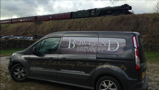 A Bowland Brewery delivery van - the brewery owned by the same group as Falcon Manor - getting a prime view of the Flying Scotsman