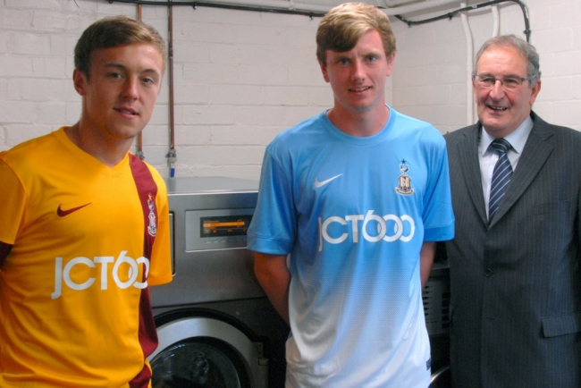 Bradford City FC players Jack Stockdill and Jack Bentley pictured with Bill Wharldall JTM chemical division manager