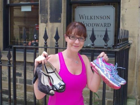 Marie Cavalier ditches the heels for her 100 mile challenge June 2014 (landscape)