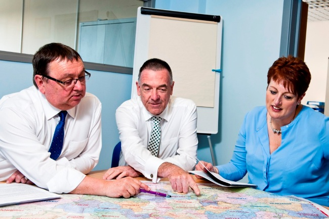 Chris Armitage (left) with Stuart and Julie Henderson of Welfare Calls