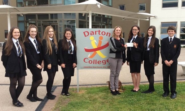Melanie Shenton, from Provide Education, presents a cheque to members of Darton Voice 2
