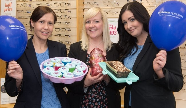 Scivens Opticians in Barnsley raising funds for Alzheimers Society with a cake sale and guess the number of sweets in the jar competition Julie Chatterton, Clair Allen and Manager Lauryn Evans