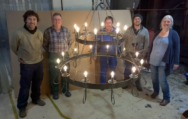 Nigel Tyas (second from left) with the team and their largest ever wrought iron chandelier 1