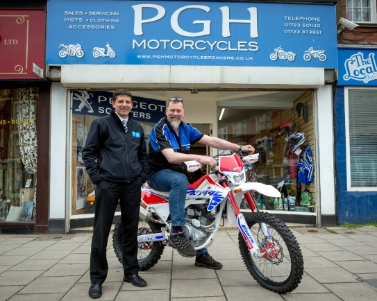 Motorcycle dealer moves up a gear with support from ...