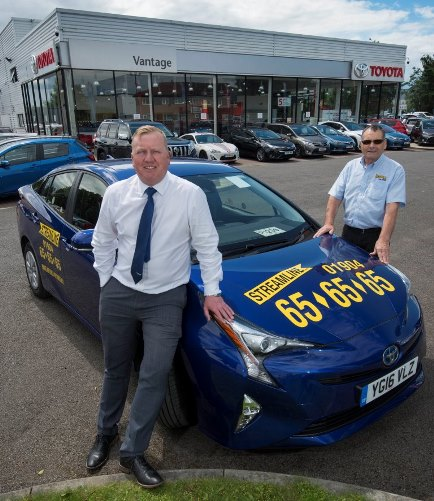 13 july 2016. Celebrating the link-up between Vantage Toyota, York, and York based taxi firm Streamline are, David Rhodes (Chairman of Streamline), right, and Glen Ramskill (Centre Principal at Toyota York).